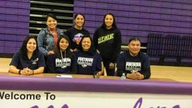 Coaches and family celebrate with Mescalero Apache High School senior Lauryn Yuzos who signed a letter of intent Monday to play basketball with Northern New Mexico Community College in Espanola in the fall.
