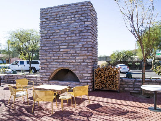 A stone fireplace adorns the patio at Tempe Public