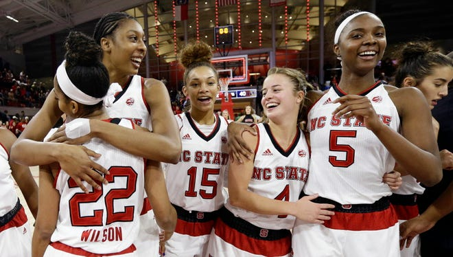 North Carolina State players celebrate after upsetting Notre Dame.