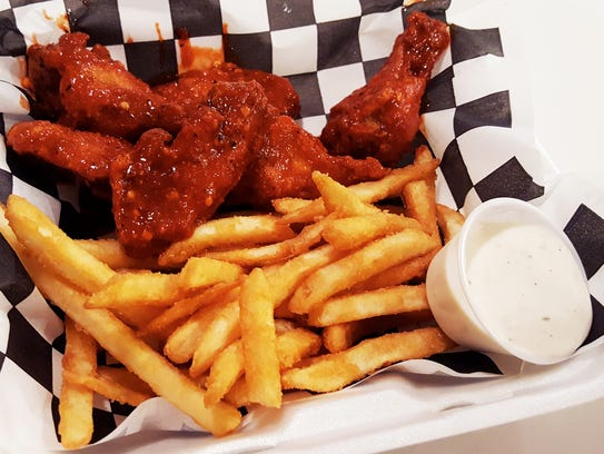 Hot Cajun wings combo ($7.99) with a side of fries