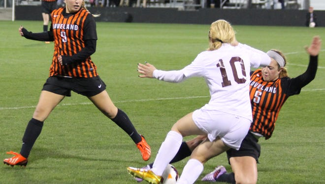 Rachel Ernst tries to win possession via slide tackle.