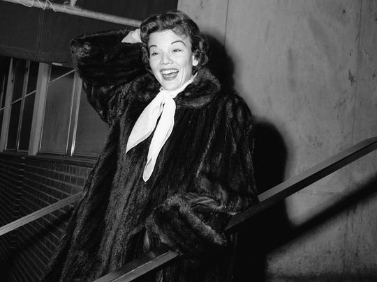 Actress Nanette Fabray poses as she leaves Mt. Sinai hospital in New York in 1955.