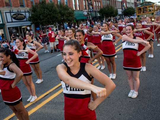 Port Huron High School cheerleaders perform during
