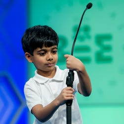 Akash Vukoti, 6, of San Angelo, Texas, tries to shorten the microphone before spelling his word during the preliminary round two of the Scripps National Spelling Bee in National Harbor, Md., Wednesday, May 25, 2016. Vukoti is the youngest speller in this year competition.