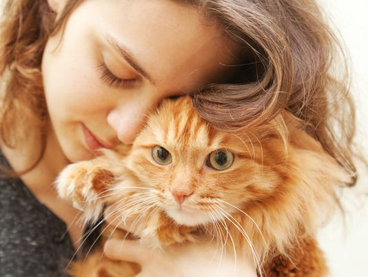 portrait of beautiful young woman with a cat