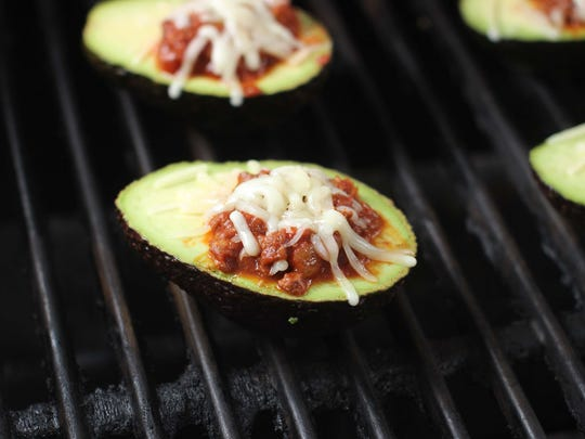 Chili stuffed avocados cook perfectly on the grill.