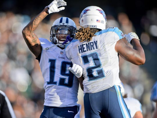 Titans running back Derrick Henry celebrates with wide receiver Tajae Sharpe after scoring in the first half against Oakland on Aug. 27, 2016.