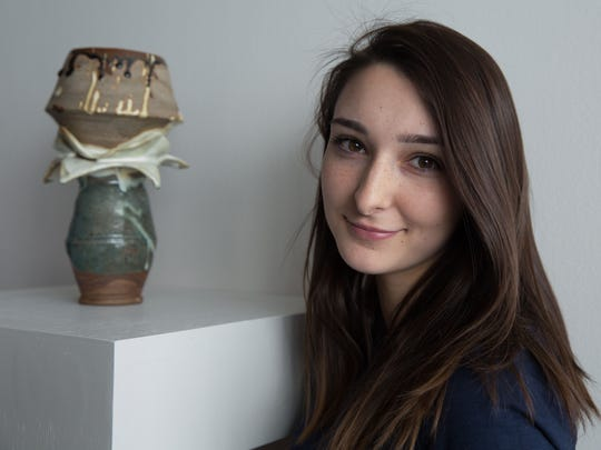 Abbey Butler poses with her American Visions Medal winning-ceramics sculpture, Equinox, in the Nevada Museum of Art Wayne and Miriam Prim Theater Lobby during the 2015 Scholastic Art Awards Ceremony, March 21, 2015.