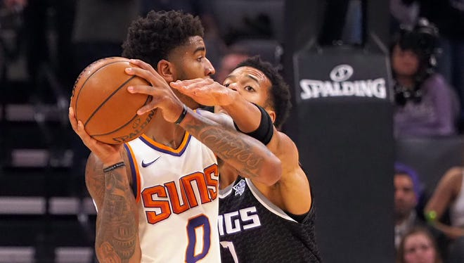 Dec 12, 2017: Sacramento Kings forward Skal Labissiere (7) reacts in against Phoenix Suns forward Marquese Chriss (0) during the first quarter at Golden 1 Center.