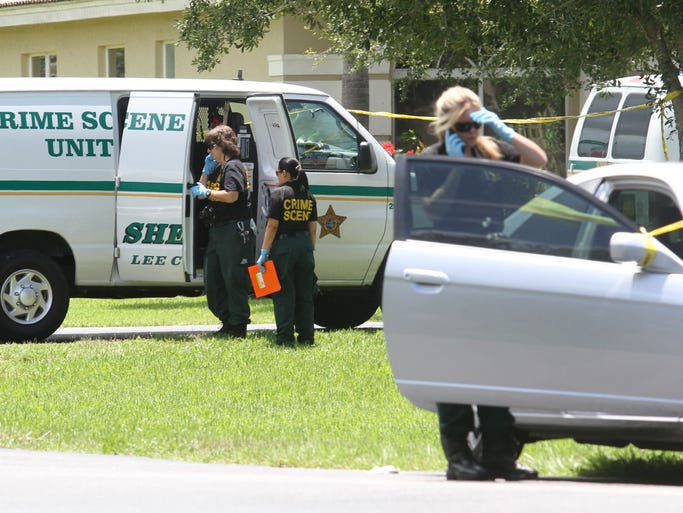 Members of the Lee County Sheriff's Office work the scene where two members of the Naples Police Department, Amy E. Young, 40, and Luis â??Daveâ? Monroig, 37,  were shot in a domestic dispute at their home in Estero on Wednesday morning.