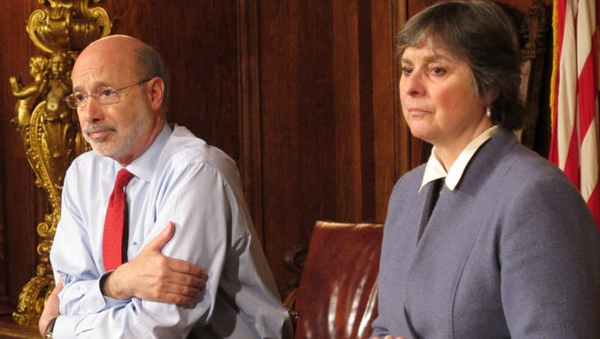 Pennsylvania Gov. Tom Wolf and his wife, Frances, listen to a reporter's question while discussing his diagnosis of what he called treatable prostate cancer in his Capitol offices, Wednesday, Feb. 24, 2016, in Harrisburg, Pa.  (AP Photo/Marc Levy)