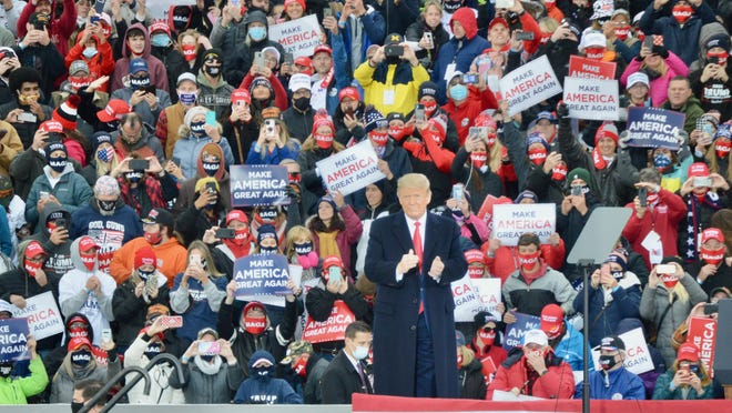 President Donald Trump arrives Saturday, Oct. 17, 2020, at the Muskegon County Airport in Muskegon, Mich., to speak with thousands of his supporters.