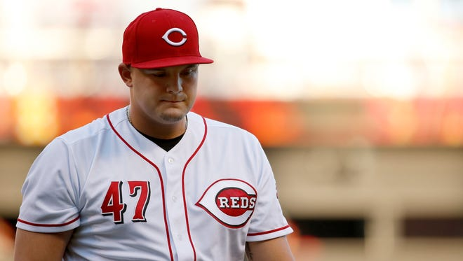Cincinnati Reds starting pitcher Sal Romano (47) returns to the dugout after the top of the first inning of the MLB National League game between the Cincinnati Reds and the San Diego Padres at Great American Ball Park in downtown Cincinnati on Tuesday, Aug. 8, 2017.