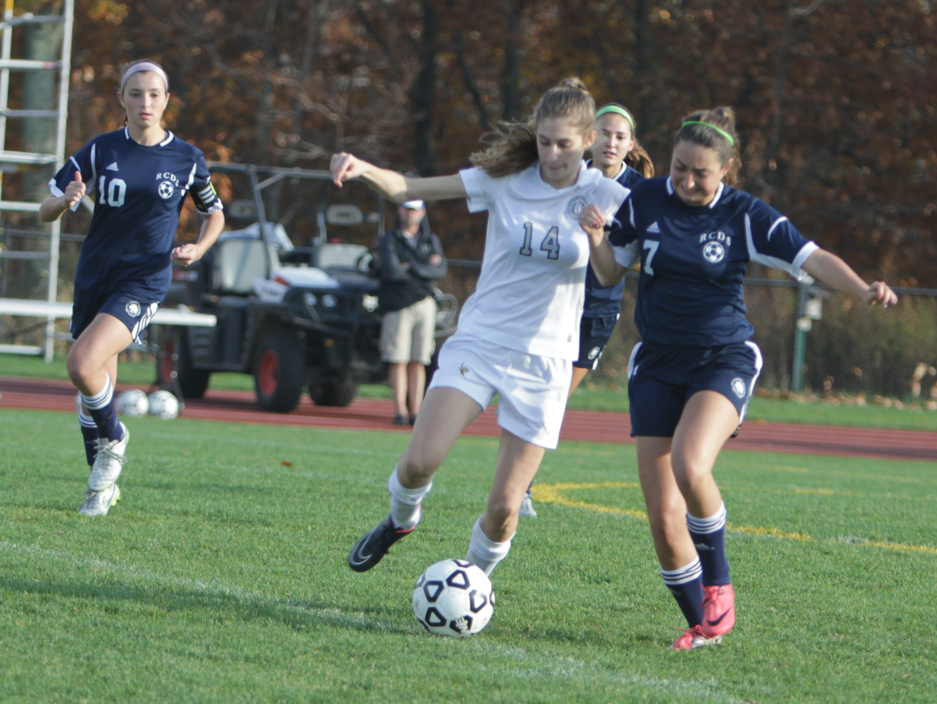 Hackley's Luisa Stalman (14) and Rye Country Day's Nicola Leake battle for possession of the ball during a NYSAIS semifinal match at the Hackley School on Friday, November 6th, 2015. Hackley won 3-1.