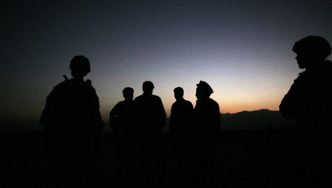 Mohammad Asim Asim, governor of Parwan province said an attacker on a motorcycle rammed a group of eight troops as they patrolled a village near Bagram Airfield.