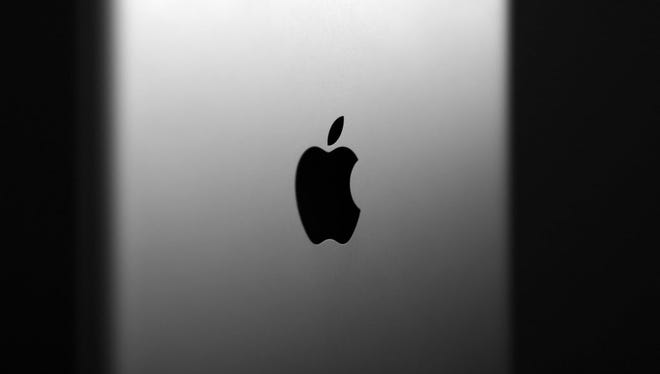 This file photo taken on August 25, 2012 shows  Picture taken on August 25, 2012 shows the logo of US group Apple on the back of its iPad tablet.