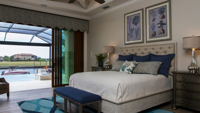 Homeowner Kathy Berg sought a Southwest Florida coastal look in her new home, reflected here in the bedroom through the use of sandy neutrals, beachy blues and sea-inspired artwork.