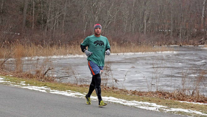 Wappingers Falls' Chris Regan runs during the Recover from the Holidays event on Jan. 7 in Staatsburg.