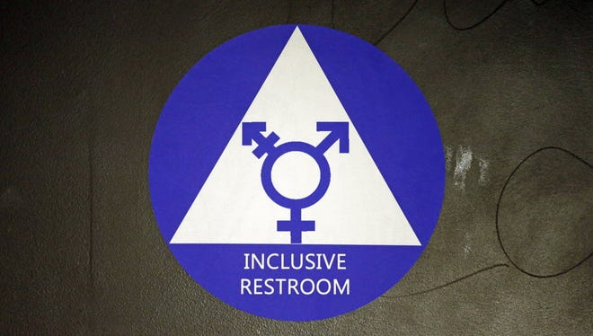 In 2016, file photo, a sticker designates a gender neutral bathroom at Nathan Hale high school in Seattle.