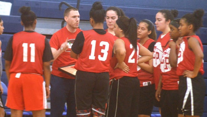 Elmwood Park girls basketball coach George Johnston talking to his team during a timeout in a scrimmage against Wood-Ridge.
