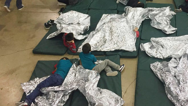 People rest in cages at a detention facility, McAllen, Texas, June 17, 2018. Corrections and clarifications: An earlier version of this column included a photograph with an incorrect date.