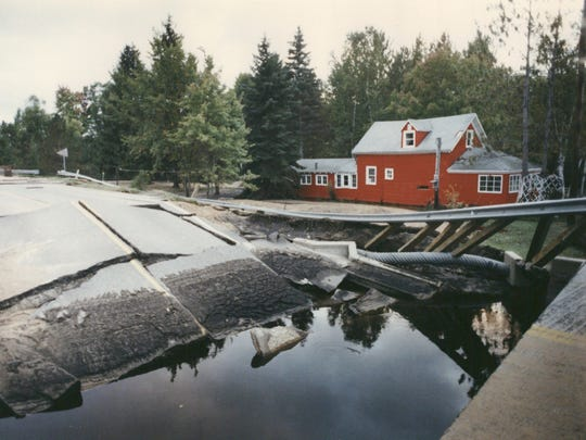 """A bridge was washed out over the White River on M-37 in White Cloud during the """"Great 1986 Flood"""" across mid-Michigan. From Sept. 10-12, 1986, 6 to 12 inches of rain dropped in a 160-mile, west-to-eastswath from the Muskegon area to the Thumb."""