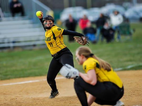 Montgomery third baseman Christine Willard throws to