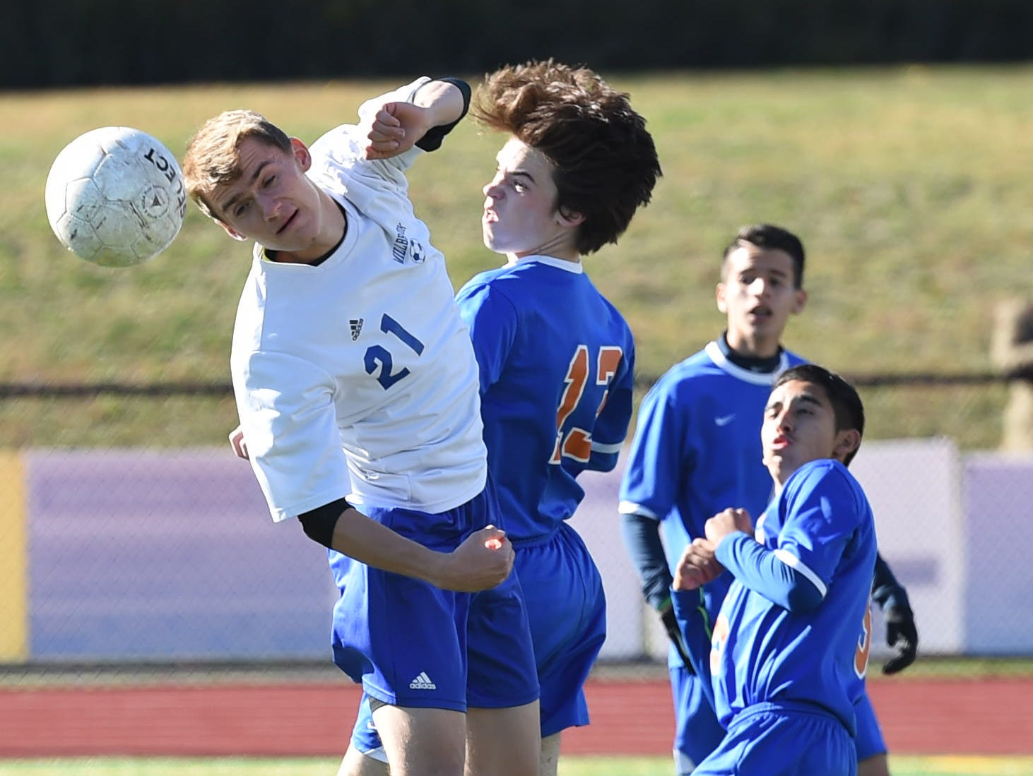 Millbrook's Chris Maresca headers the ball away from Chester's Aidan O'Connor during Monday's sectional semifinal game.