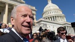 Former vice president Joe Biden pauses as he greets