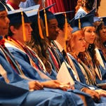 Graduates look at on the crowd during North Forrest High School's graduation ceremony on the campus of Southern Mississippi.