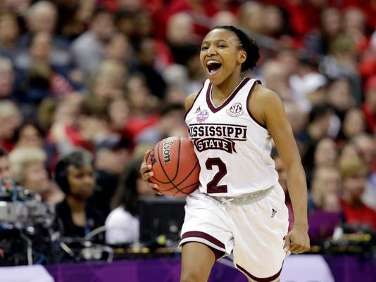 Mississippi State's Morgan William (2) celebrates during overtime against Louisville in the semifinals of the women's NCAA Final Four college basketball tournament, Friday, March 30, 2018, in Columbus, Ohio. Mississippi State won 73-63. (AP Photo/Tony Dejak)