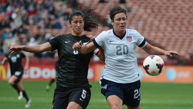 Abby Wambach, right, battles for the ball with New Zealand defender Abby Erceg during a 2013 exhibition match. Erceg is the captain of the WNY Flash and her country's team, which plays the U.S. in Wednesday's Olympic opener at 6 p.m.