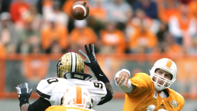 Tennessee quarterback Erik Ainge fires a pass past against Vanderbilt in 2007.