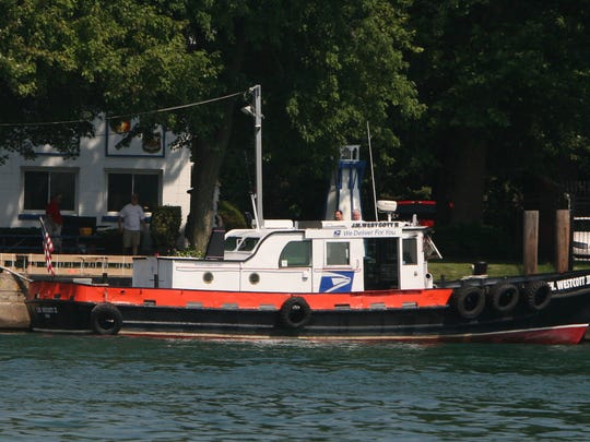 The J. W. Wescott mail boat that has its own zip code, taking mail and supplies to passing freighters on the Detroit River.