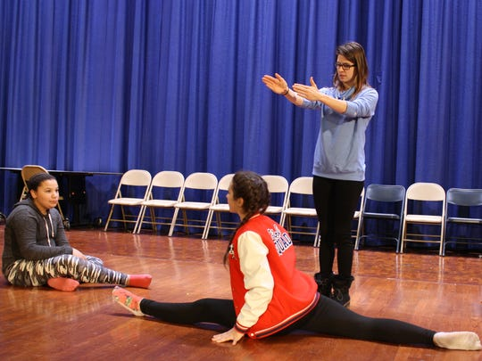 Lauren Balogh instructs seventh-grade dancers at West