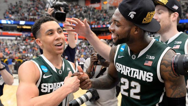 Seniors Branden Dawson and Travis Trice smile after reaching the Final Four for the first time Sunday