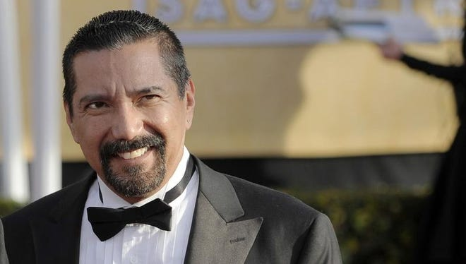 """This Jan. 27, 2013 file photo shows actor Steven Michael Quezada at the 19th annual Screen Actors Guild Awards in Los Angeles. Tony Award-winning actor Bryan Cranston is giving fellow actor Quezada, from """"Breaking Bad"""" some help in his race for a New Mexico county commissioner's seat. Cranston is joining comedian George Lopez in asking some residents of the state's largest county to vote for Quezada in a county commissioner's race. They are promoting Quezada on mailers targeting voters"""