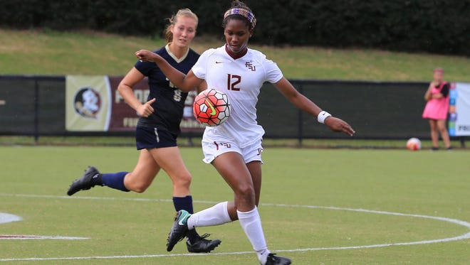 FSU junior midfielder Kaycie Tillman (12) takes control of the ball during the second half against Pittsburgh at the Seminole Soccer Complex.