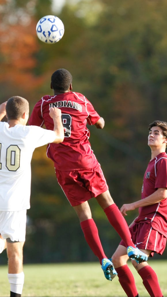 Nyack's Wismento Saint-Germain (8) goes up for a header against Nanuet's Andrew Bluteg during a boys soccer game at Nanuet High School on Wednesday, Oct. 21, 2015.