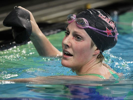 FILE - In this Jan. 16, 2016, file photo, Missy Franklin watches the results board of the women's 200-meter backstroke during the Arena Pro Swim Series, in Austin, Texas. The Olympic champion with the perpetual smile concedes that subpar performances over the past year have gotten under her skin just a bit. (AP Photo/Stephen Spillman, File)