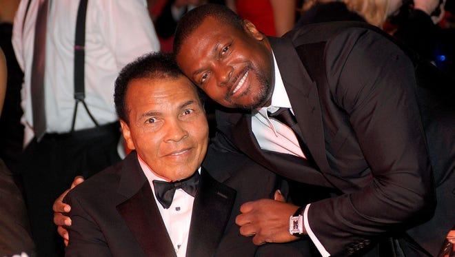 Muhammad Ali and Chris Tucker attend Celebrity Fight Night XVI on March 20, 2010, in Phoenix, Arizona.