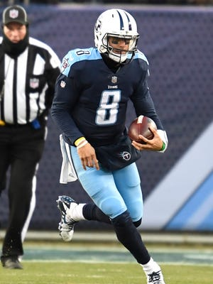 Titans quarterback Marcus Mariota scrambles in the second quarter Sunday.