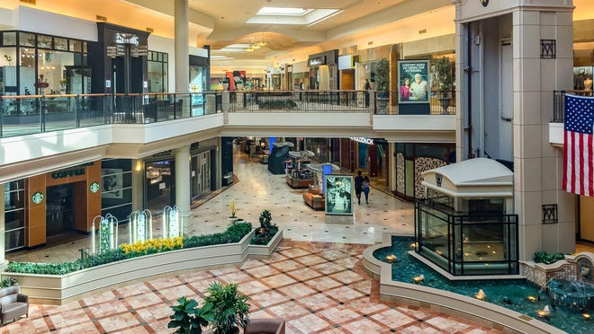 The Mall at Wellington Green is nearly empty and many stores are shuttered in Wellington, Fla., on Thursday, March 19, 2020.