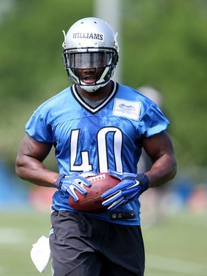 Running back Rasheed Williams goes through drills during Detroit Lions rookie minicamp in Allen Park on May 10, 2015.