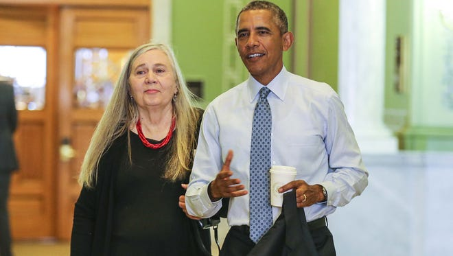 President Barack Obama arrives at the State Library with Iowa author Marilynne Robinson, left, in Des Moines, Iowa, Monday Sept. 14, 2015.