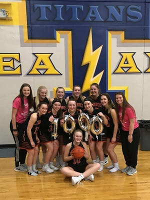 Lennox sophomore Madysen Vlastuin (seated) scored her 1,000th career point over the weekend.