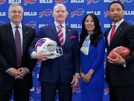 Terry Pegula, coach Sean McDermott, Kim Pegula and