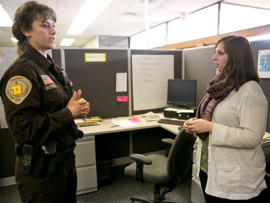 Officer Penny Borski helps reporter Sari Lesk set up
