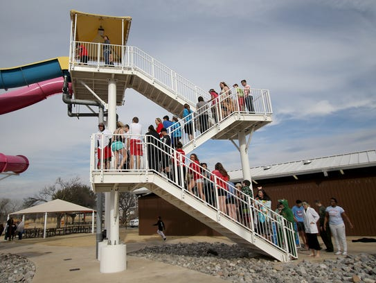 People stand in line and wait to take the polar plunge