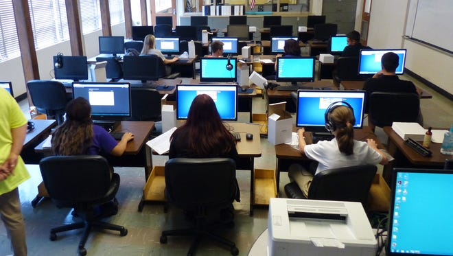 Students in the first day of class at Edward J. Sam Accelerated School of Lafayette.